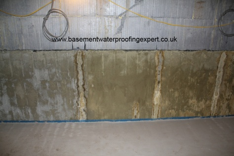 ICF with waterproof concrete admix system, water penetration occurring where the ties penetrate through the concrete - inner face of polystyrene stripped to expose concrete.