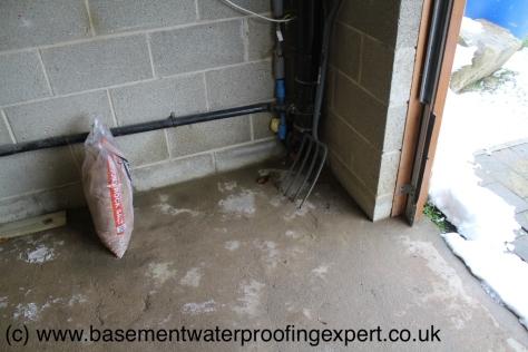 Saturated garage floor construction.