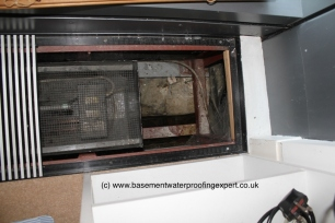 Example of recessed duct contining electric heating element.