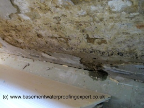 Friable render removed, water ingress through wall.