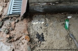 We formed a small excavation in the bedding material to expose the structural deck beneath.